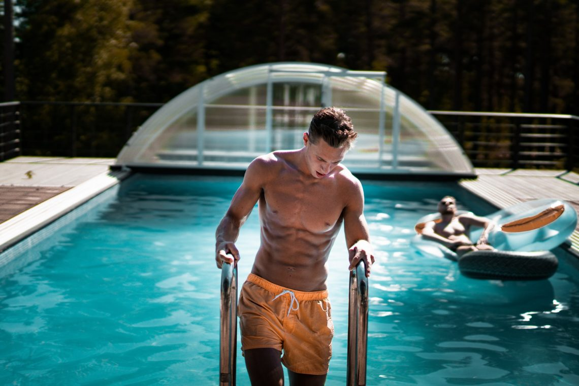 man getting out of the pool with great abs cooltone vs coolsculpting